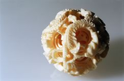 Carved Ivory Ball. A carved Chinese ivory ball made of concentric spheres with a dragon motif Stock Photography