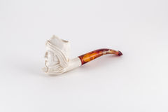 Carved ivory smoking pipe. The head of the pipe is carved from ivory in the shape of a man's head from the 17 or 18th centuries royalty free stock image
