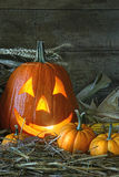 Carved jack-o-lantern lit for Halloween. In the barn Royalty Free Stock Image