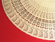 Carved japanese fan. Beautifully stensiled Carved wooden japanese fan on red velvet cloth Royalty Free Stock Image