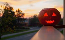 Carved Lighting Pumpkin. Lighting carved pumpkin, with beautiful sunset background. Haloween stuff stock photo