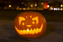 Carved lit Halloween pumpkin Royalty Free Stock Photos