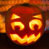 Carved lit Halloween pumpkin Stock Photos