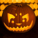Carved lit Halloween pumpkin Royalty Free Stock Images