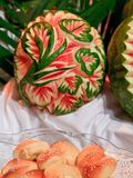 Carved Melon. Intrinsic floral patterns are carved into watermelons and put on display stock images