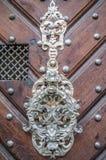 Carved metal door handle Stock Images