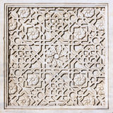 Carved ornament on the marble tile Royalty Free Stock Photography