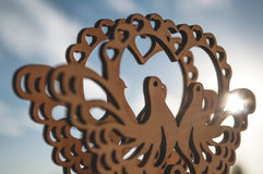 Carved out of wood pigeons. And sunlight royalty free stock image