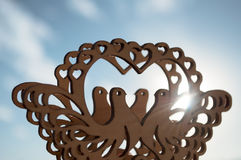 Carved out of wood pigeons. And sunlight royalty free stock photos
