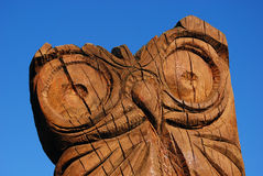 Carved Owl Sculpture. Horizontal version, on isolated background Stock Photography