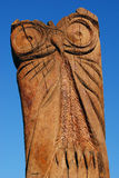 Carved Owl Sculpture. Vertical version, on isolated background royalty free stock images