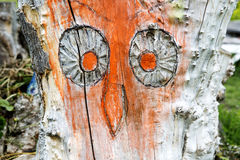 Carved owl in a tree trunk Stock Image