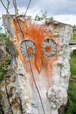 Carved owl in a tree trunk Stock Photo