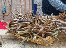 Carved and painted deer antlers in market in finland. Finnish market Helsinki, with hand crafted and decorated deer antlers. Traditional folk crafts of finland Stock Photography