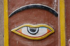 Hindu Temple Eye, Kathmandu, Nepal. This is a carved and painted eye on the wall of a Hindu temple in Kathmandu, Nepal stock photo