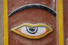 Hindu Temple Eye, Kathmandu, Nepal. This is a carved and painted eye on the wall of a Hindu temple in Kathmandu, Nepal Stock Photo