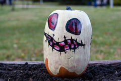 Carved and Painted Halloween pumpkin Stock Images