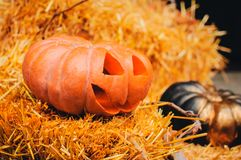 A carved and a painted pumpkin stock photos