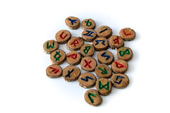 Carved and painted wooden oak runes on white Royalty Free Stock Photo
