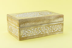 Carved pale wood box isolated on yellow background. Carved pale wood box isolated on yellow stock photography