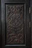 Carved panel of an old wooden door. Decorative pattern carved on a rectangle panel of an old-fashioned wooden door Royalty Free Stock Photos
