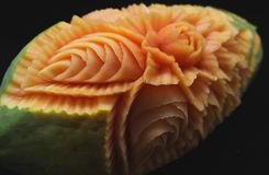 Carved Papaya. Beautiful artistic Carved papaya fruits Royalty Free Stock Image