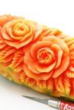 Carved papaya fruit and knife Royalty Free Stock Photography