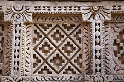 Carved Patola Double Ikat pattern on the inner wall of Rani ki vav, an intricately constructed stepwell on the banks of Saraswat. I River. Memorial to an 11th Royalty Free Stock Photography