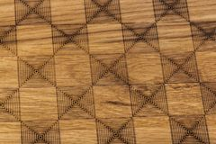 Carved pattern on wood background Royalty Free Stock Photography