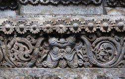 Carved patterns on historical walls of indian stone temple Hoysaleswara, India. Temple was built in 1150 Stock Photography