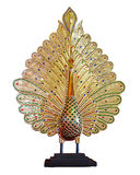 Carved peacock. Royalty Free Stock Images
