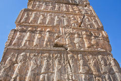 Carved people on the destroyed stone bas-relief in famous city Persepolis Royalty Free Stock Photography