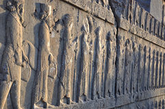 Carved Persians on the stone wall in Persepolis Royalty Free Stock Photos