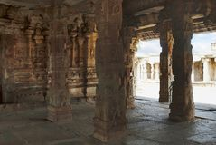 Carved pillars of the maha-mandapa, Krishna Temple, Hampi, Karnataka. Interior view. Sacred Center. A large open prakara is seen i. Carved pillars of the maha stock photo