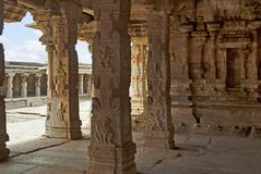 Carved pillars of the maha-mandapa, Krishna Temple, Hampi, Karnataka. Interior view. Sacred Center. A large open prakara is seen i. Carved pillars of the maha royalty free stock photography