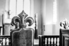 Carved Poppy Head Bench in Medieval English Church HDR BW Stock Photography