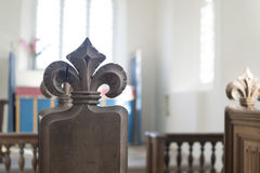 Carved Poppy Head Bench in Medieval English Church Stock Images