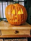 Carved pumpkin on baker& x27;s rack royalty free stock image