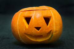 Carved pumpkin face with a smile Royalty Free Stock Photos