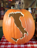 Carved pumpkin at Italian restaurant in historic Little Italy in lower Manhattan. stock image