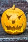 Jack-o-lantern with evil eye stock images