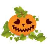 Carved pumpkin. Orange pumpkin carved with leaves Stock Images