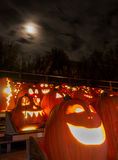 Carved pumpkins and moonlight Royalty Free Stock Images