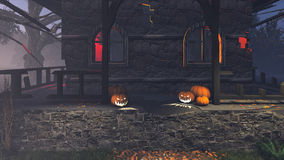 Carved pumpkins on the porch at night Stock Photos