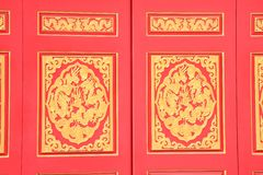 Carved red window Stock Photos
