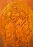 Carved relief of Saint Christine as clannish patroness from wine cellar Stock Image