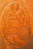 Carved relief of Saint Mark as clannish patron from wine cellar Royalty Free Stock Photography