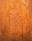 Carved relief of Saint Peter as clannish patron from wine cellar Stock Photos