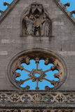 Carved religious scene and stoned empty rose window in Leon cath. Detail of carved religious scene and stoned rose window inthe main facade of the gothic Royalty Free Stock Image