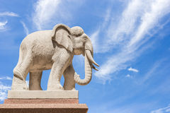 Carved sandstone elephant on blue sky background Royalty Free Stock Photos